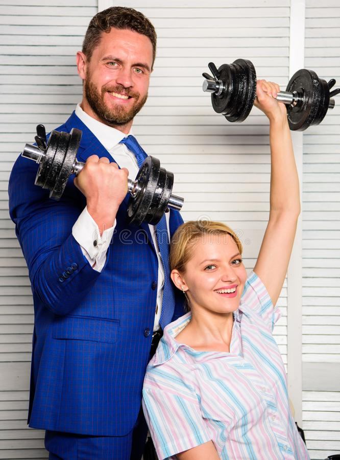 Key to success concept. Man and woman raise heavy dumbbells. Strong powerful business strategy. Boss businessman manager. Key to success concept. Man and women stock images