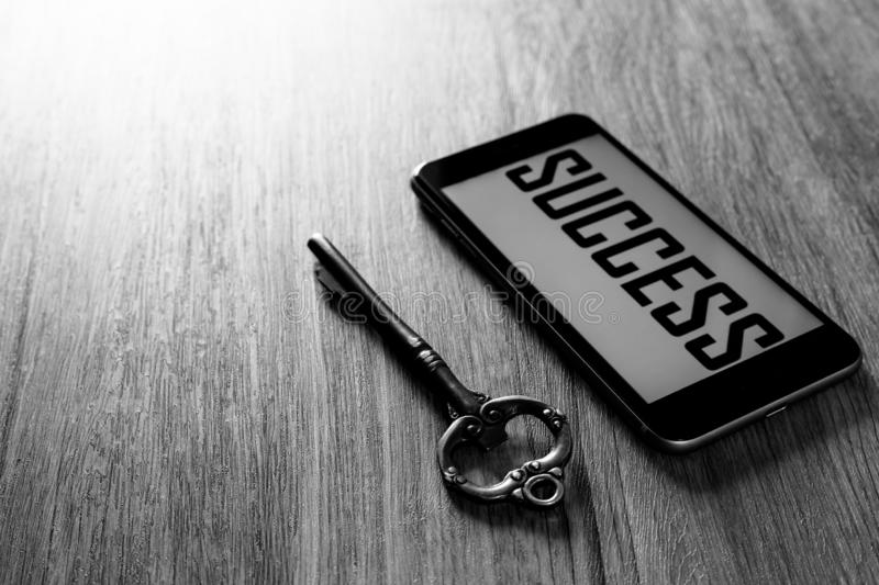 Key to success, smart phone with key of success royalty free stock photography