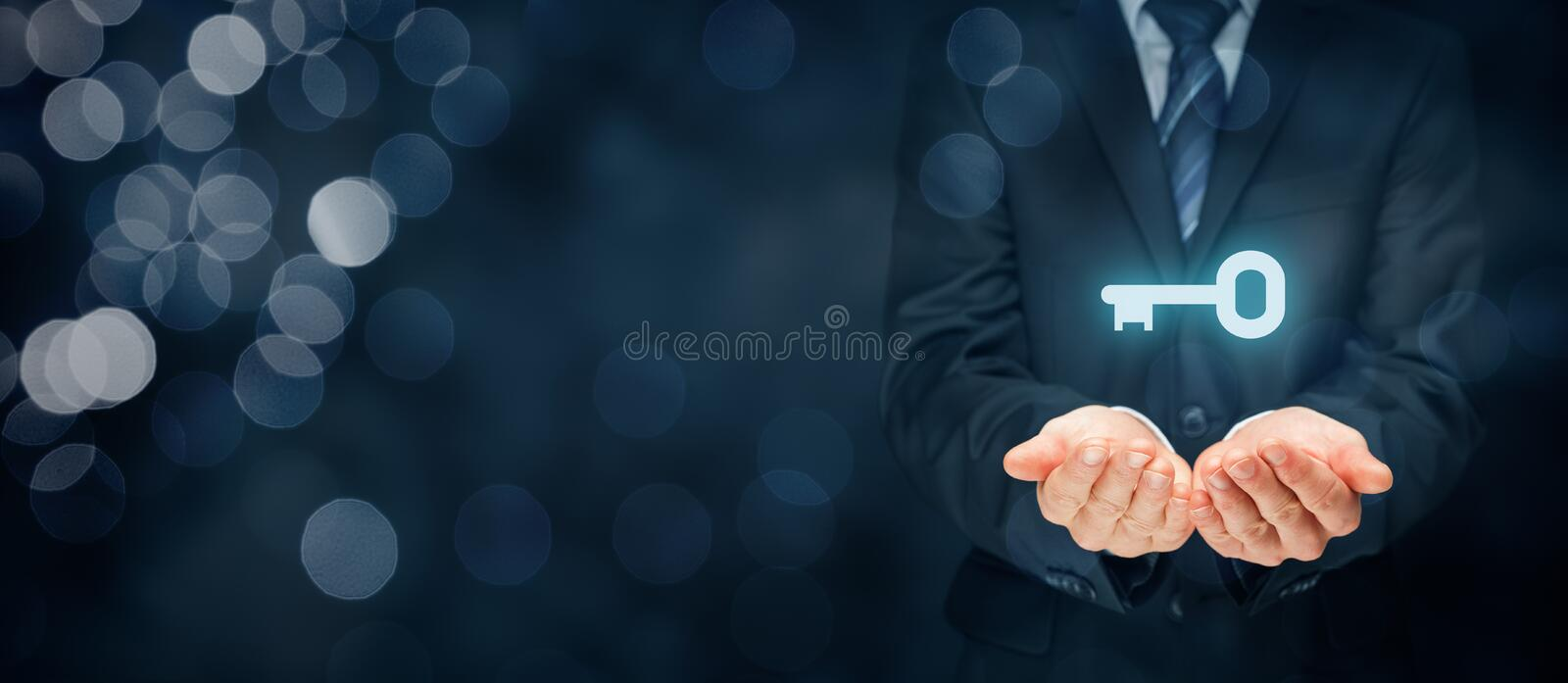 Key to success or solution. Businessman consultant, coach, leader, customer service, CEO or another business person offer key to success or solution. Turnkey stock photo