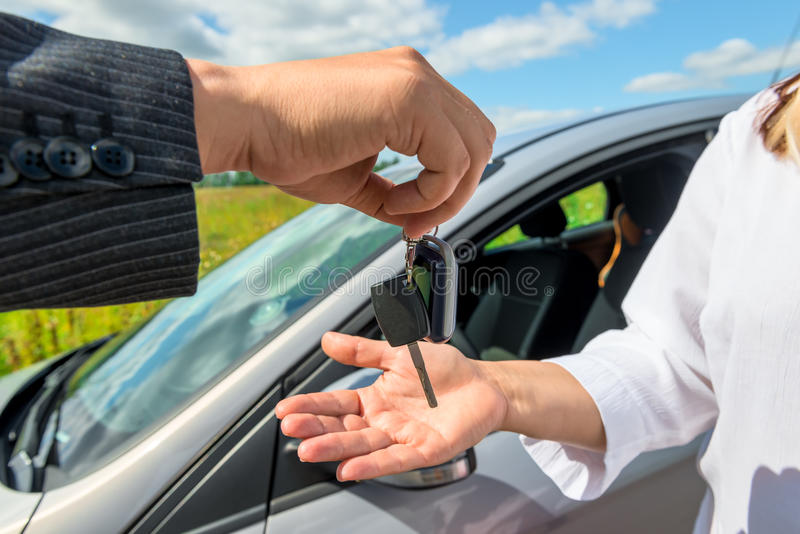 Key transfer into the hands of the buyer stock photo
