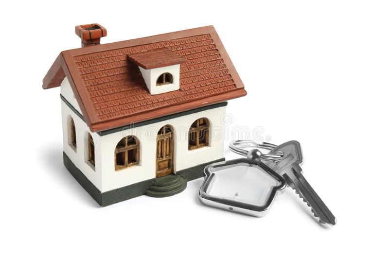 Key with trinket and house model royalty free stock photo