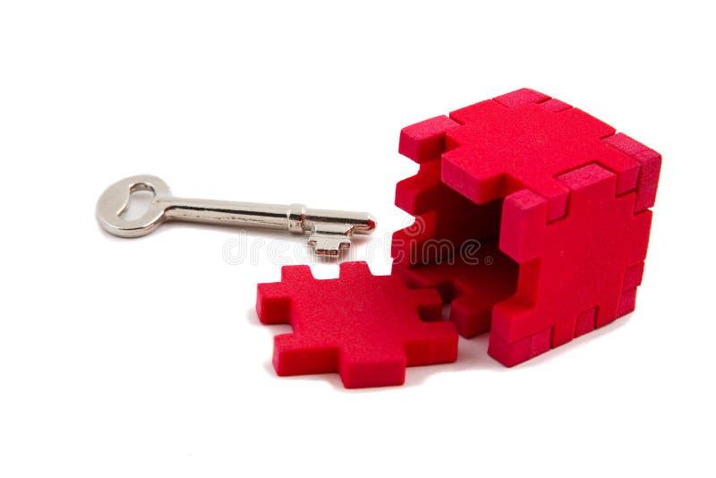 Key unlocks puzzle royalty free stock image