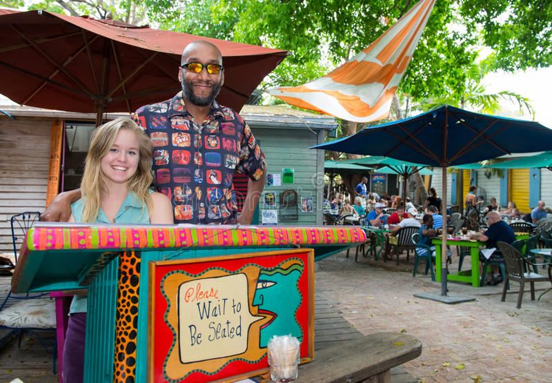 Хозяюшка в голубом кафе рая в Key West стоковая фотография
