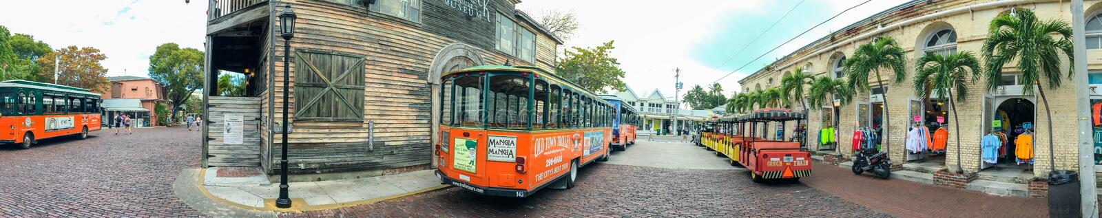 KEY WEST, FL - FEBRUARY 2016: Old Trolleys along city streets, p. Anoramic view. Key West is a major tourist destination in Florida stock photo