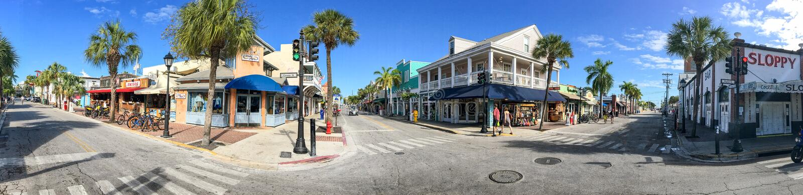 KEY WEST, FL - FEBRUARY 2016: Tourists along city streets, panoramic view. Key West is a major tourist destination in Florida.  royalty free stock image
