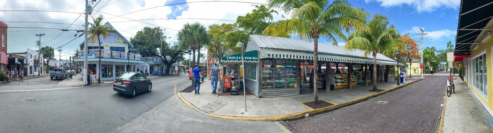KEY WEST, FL - FEBRUARY 2016: Tourists along city streets, panoramic view. Key West is a major tourist destination in Florida.  royalty free stock photos