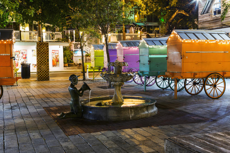 KEY WEST, FL - 10 JAN 2016: The tropical city is a popular tourist destination with over 2 million yearly visitors. KEY WEST, FL - 10 JAN 2016: Fountain with a stock photos