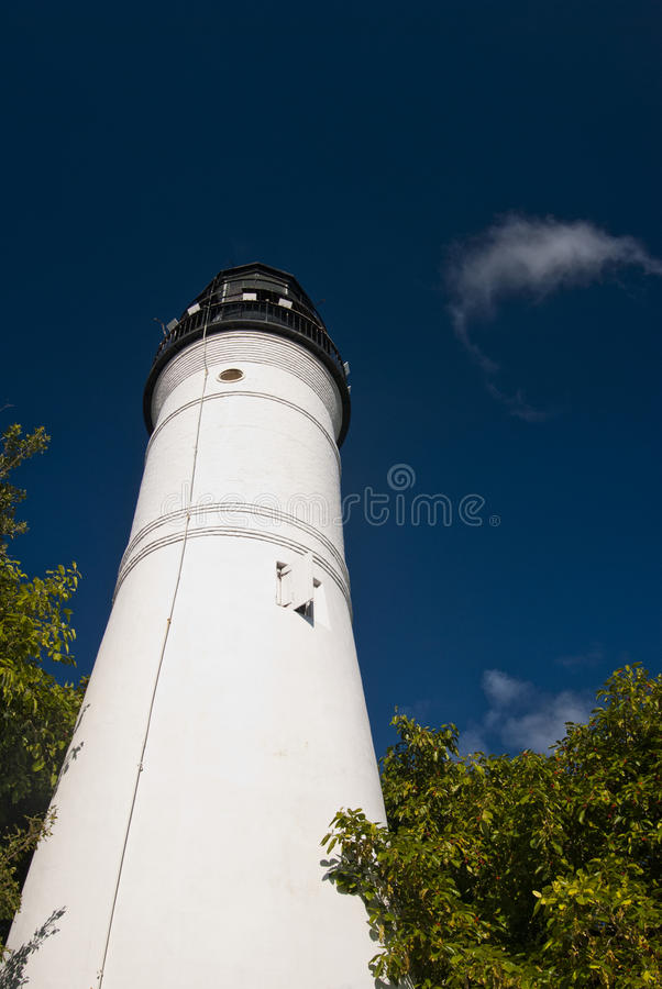 Key West Lighthouse. View of Key Biscayne lighthouse from the beach in a sunny day with clouds - Miami (USA - 2010 stock photography