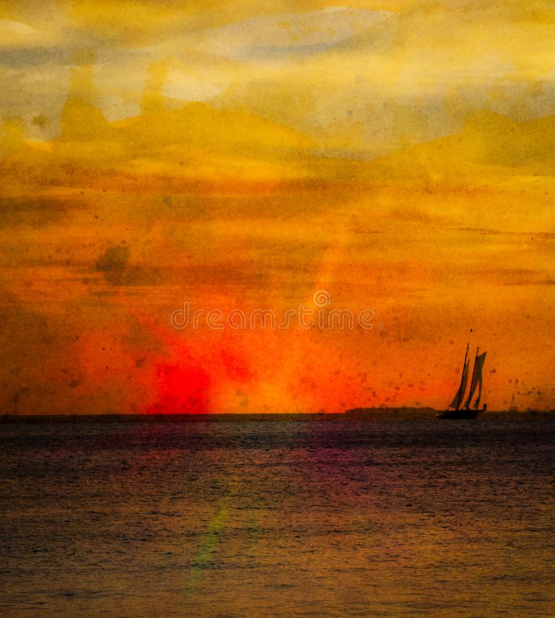 Key West solnedgång med ett seglingskepp på den orange horisonten royaltyfri foto