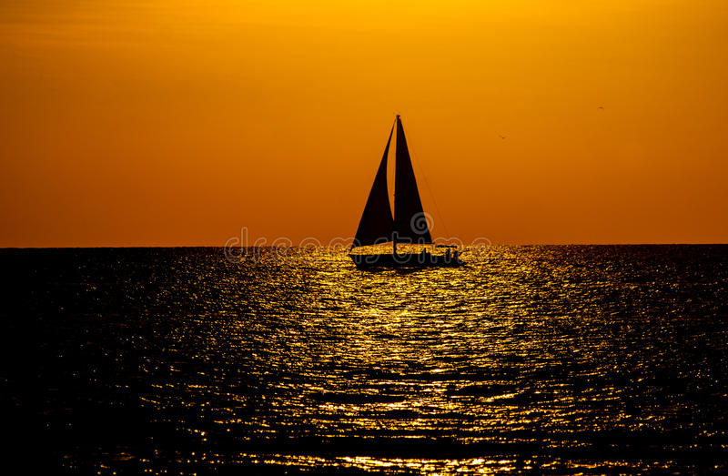 key west sunset with sailboat silhouette stock image - image of