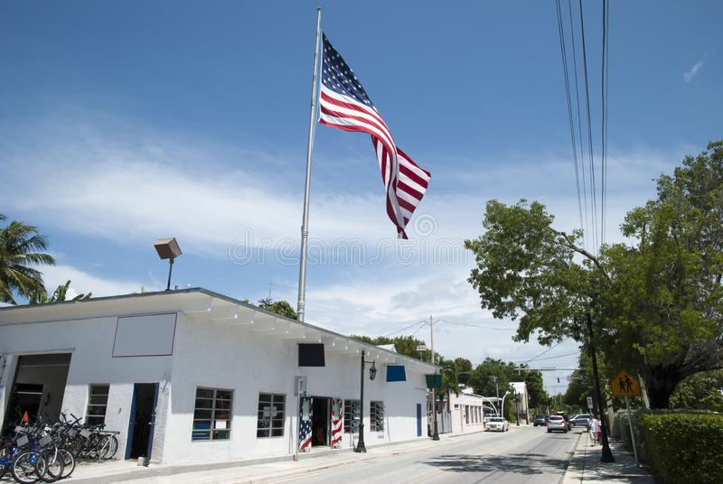 Key West Town Truman Avenue. The view of Truman Avenue with a big flag in Key West town Florida royalty free stock photo