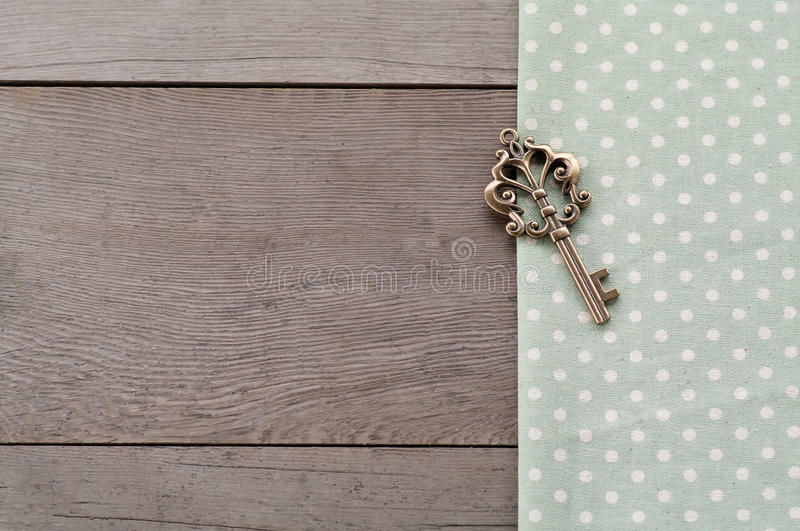 Key on wood textured background royalty free stock photography
