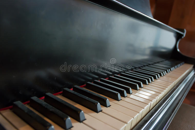 Keyboard of Accoustic Piano. Accoustinc pinao in a piano bar. The Piano Bar consists of a piano played by a professional musician, located in a cocktail lounge royalty free stock photos