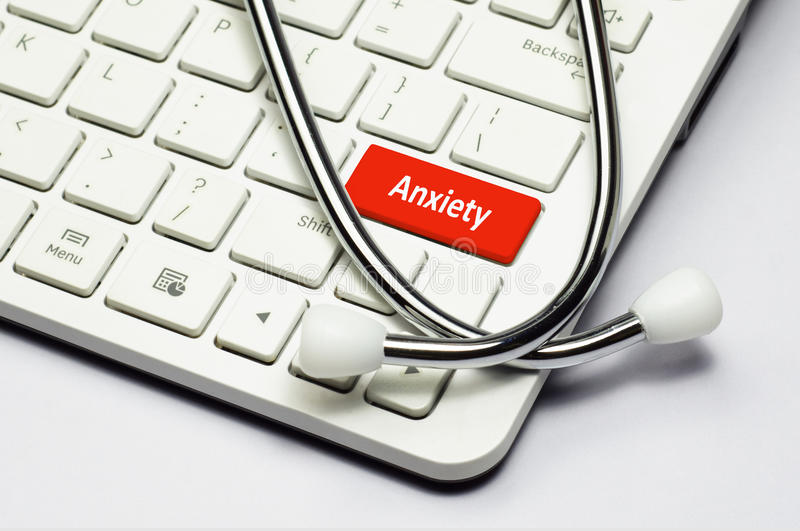 Keyboard, Anxiety text and Stethoscope. Anxiety text, stethoscope lying down on the computer keyboard royalty free stock image