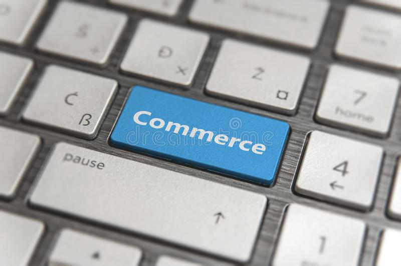 Keyboard with blue key Enter and word Commerce button modern pc stock photography