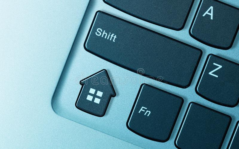 Concept of real estate buying, selling, booking. Keyboard button in form house as a metaphor for real estate buying, selling, booking royalty free stock photos
