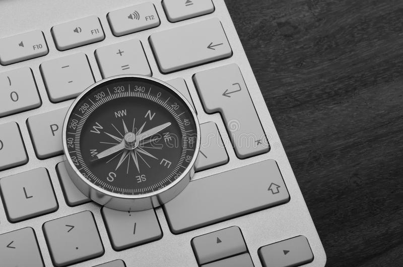 Keyboard with compass black and white stock images