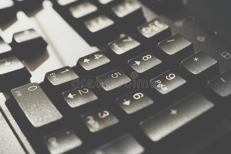 Keyboard for computer server or desktop computer. Focus on numeric keypad button on a keyboard in office, business and information technology concept stock photos