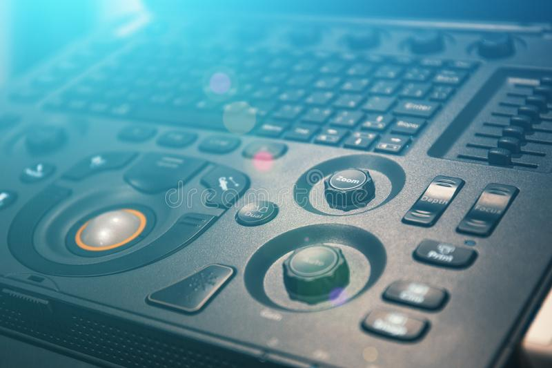 Keyboard with control elements and buttons of medical equipment of ultrasound scanner for diagnostic and analyzing. Close up royalty free stock images