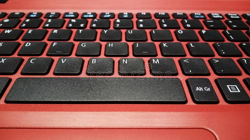 Keyboard covered by super reddish color royalty free stock photography