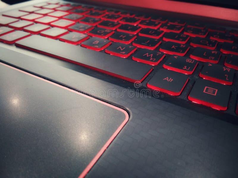 Keyboard gaming close up,  Red blacklight,  Computer laptop keyboard, Red dark wallpaper. Keyboard gaming close up,  Red blacklight, Computer laptop red dark stock photography