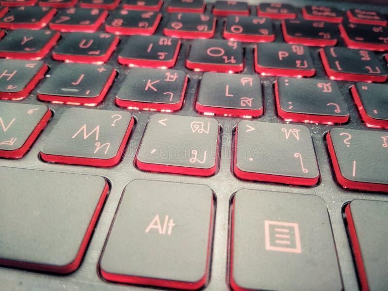 Keyboard gaming close up,  Red blacklight,  Computer laptop keyboard, Red dark wallpaper. Keyboard gaming close up,  Red blacklight, Computer laptop red dark stock photos