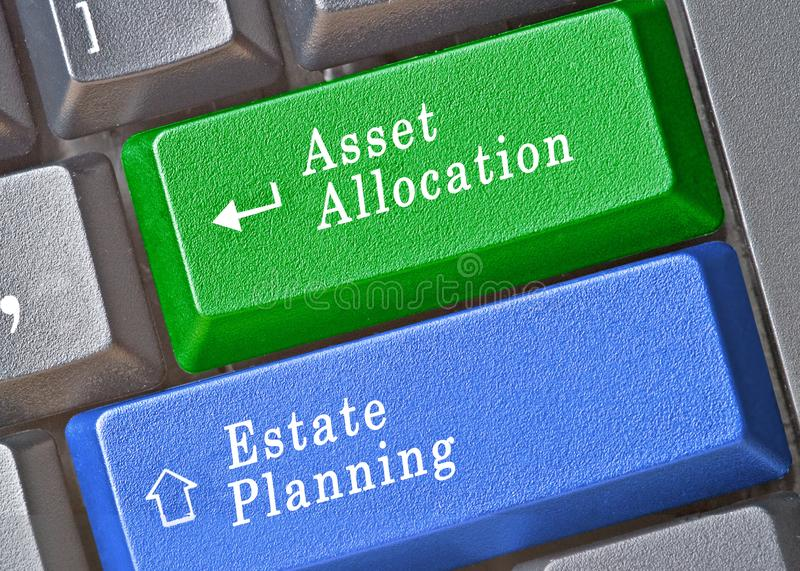 Keys for asset allocation and estate planning. Keyboard with keys for asset allocation and estate planning stock photography