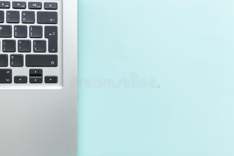 Keyboard laptop computer isolated on blue pastel desk background. Modern Information technology and sofware advances stock image