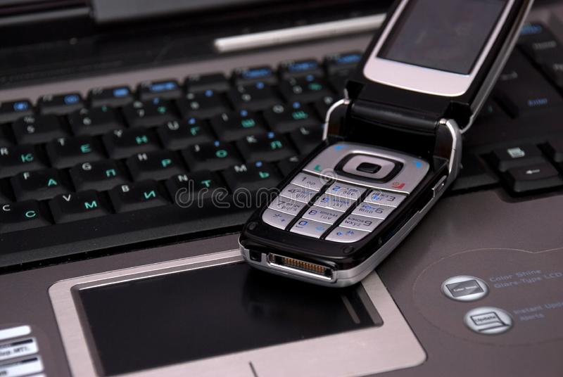 Keyboard of laptop and smartphone on it. stock images