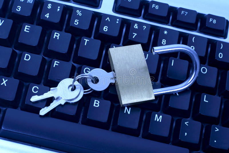 Keyboard and lock with the keys. The keyboard and lock with the keys stock photography