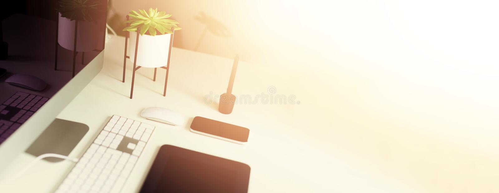 Keyboard, mouse, computer display with black blank screen. Front view. Designer workspace on grey background. Minimalistic home. Office. Copy space. Banner royalty free stock images