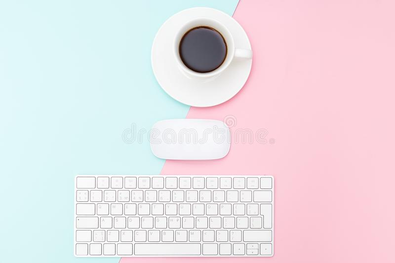 Keyboard and Mouse on two tone pastel background. Minimalist sty stock photos