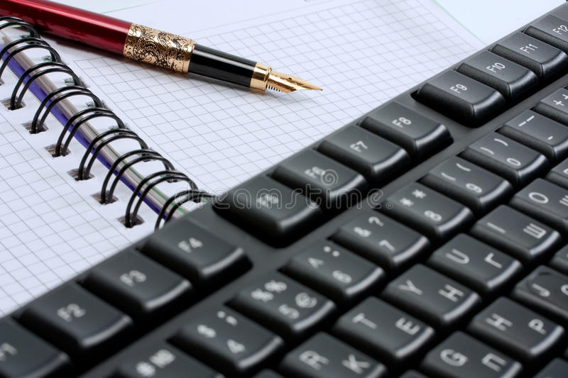 Keyboard And Note Pad Stock Photography