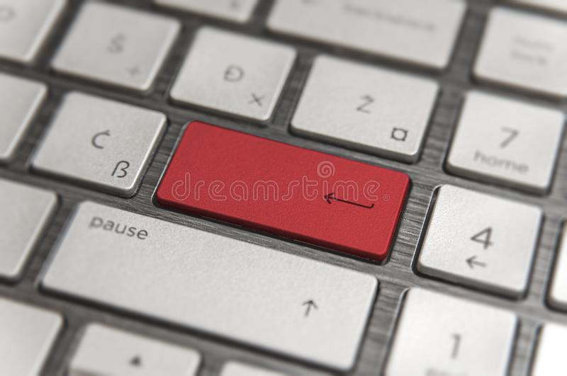 Keyboard with red blank Enter button modern pc text communication. Board stock photography