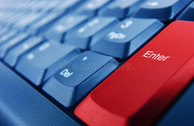 Keyboard with red enter button. Blue keyboard with red enter button stock photos