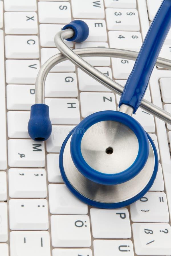 Keyboard and stethoscope stock photo