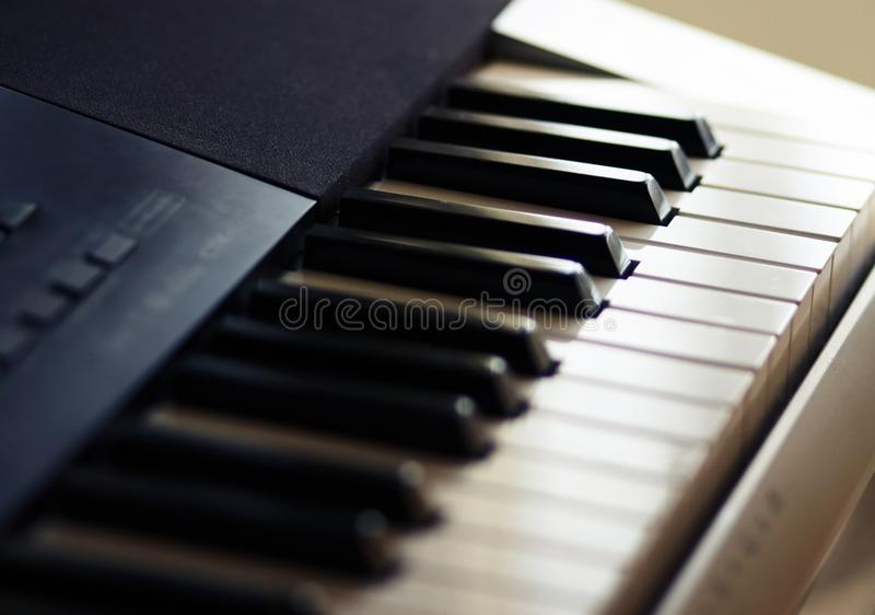 The keyboard synthesizer for performance of various musical parties stands royalty free stock image