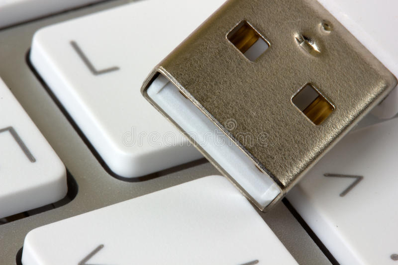 Keyboard and usb devise. White keyboard and usb devise close up stock images