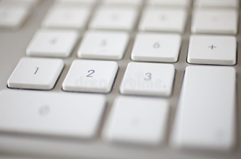 Keyboard white elegant closeup 4. White elegant keyboard closeup soft focus on numeric part stock photo