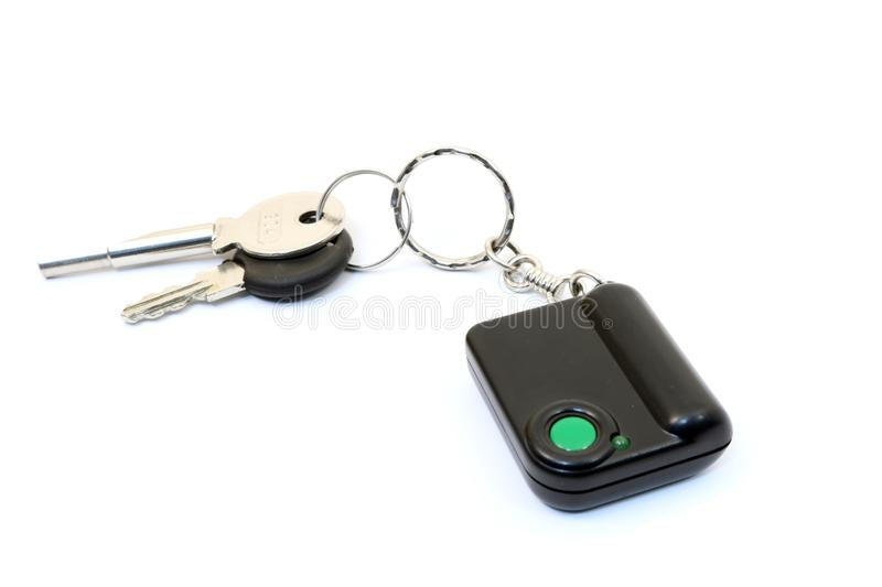 Keychain with button for calling security. Button for fast mobile help. Button for calling bodyguard stock photography