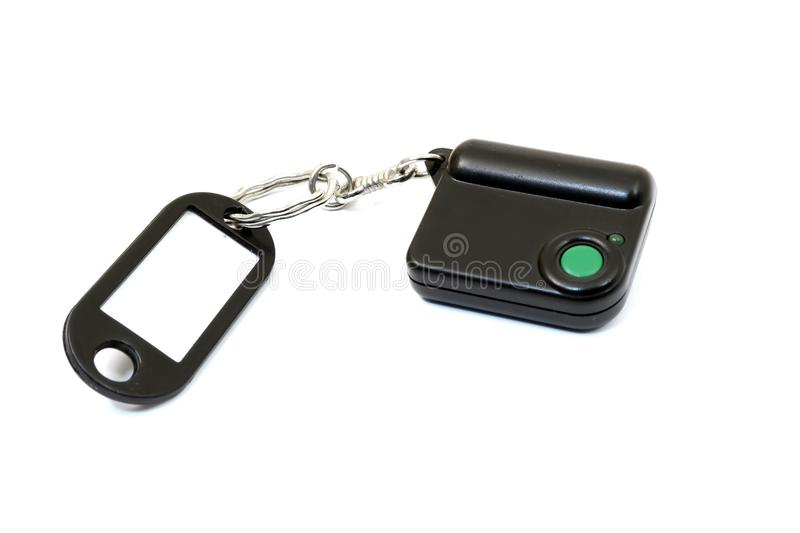Keychain with button for calling security. Button for fast mobile help. Button for calling bodyguard stock photo