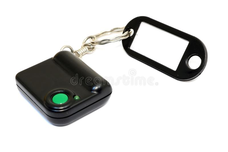 Keychain with button for calling security. Button for fast mobile help. Button for calling bodyguard royalty free stock photography