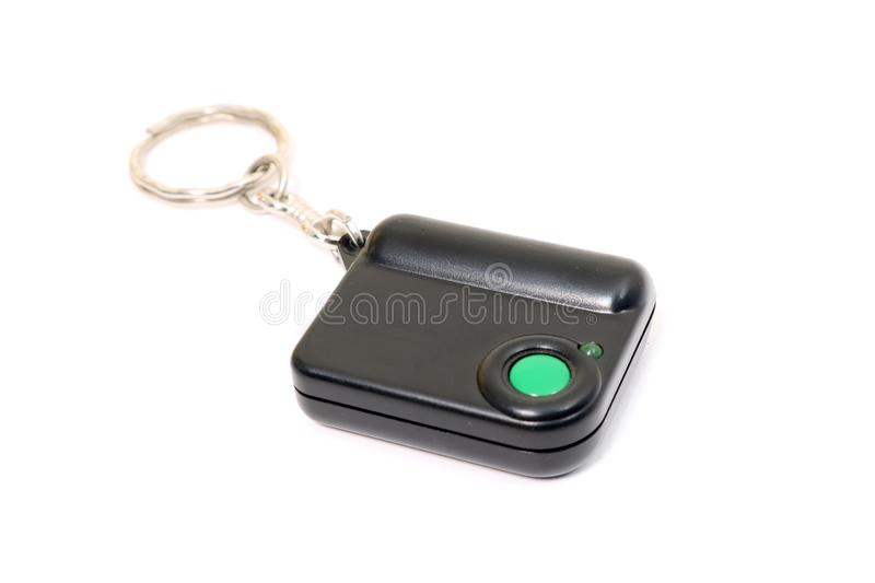 Keychain with button for calling security. Button for fast mobile help. Button for calling bodyguard stock image