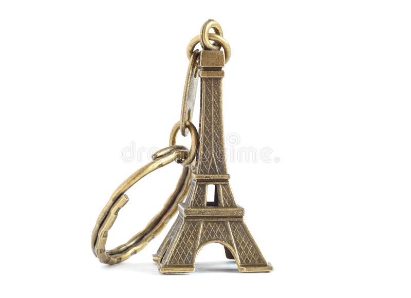 Keychain Eiffel tower. On white stock image