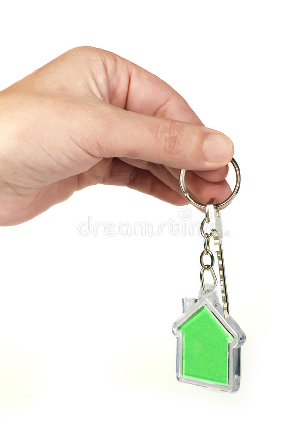 Keychain with figure of green house. Hand holding key and Keychain stock images
