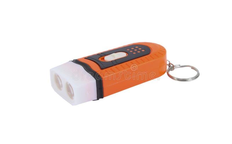 Keychain led flashlight. Plastic keychain LED flashlight isolated on a white royalty free stock photo