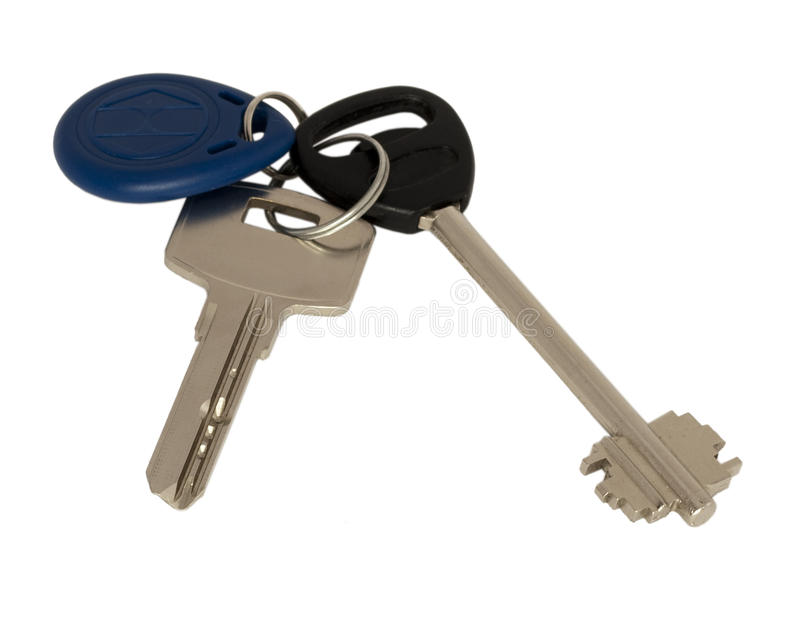 Keychain. Two common key and an electronic key. Keychain. Two common metall key and an electronic plastic blue key. Isolated on white stock photos