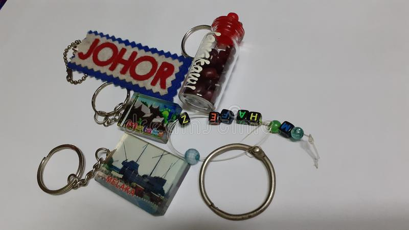 Keychains souvenir. Of malaysia close up royalty free stock photo