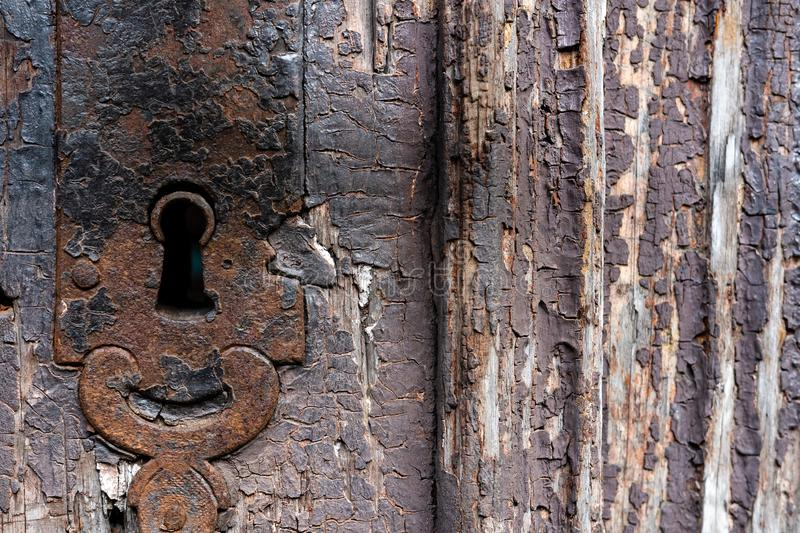 Keyhole in ancient doors with damaged color stock images