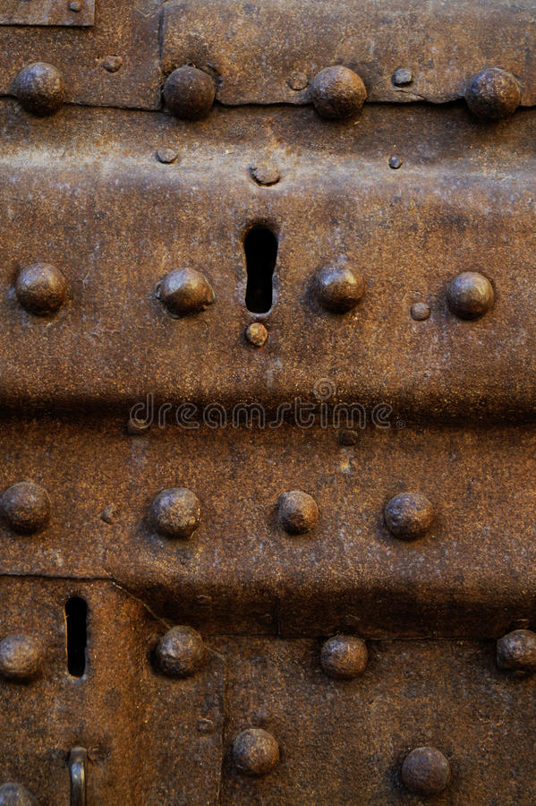 Keyhole. Old neglected keyhole in iron door royalty free stock image